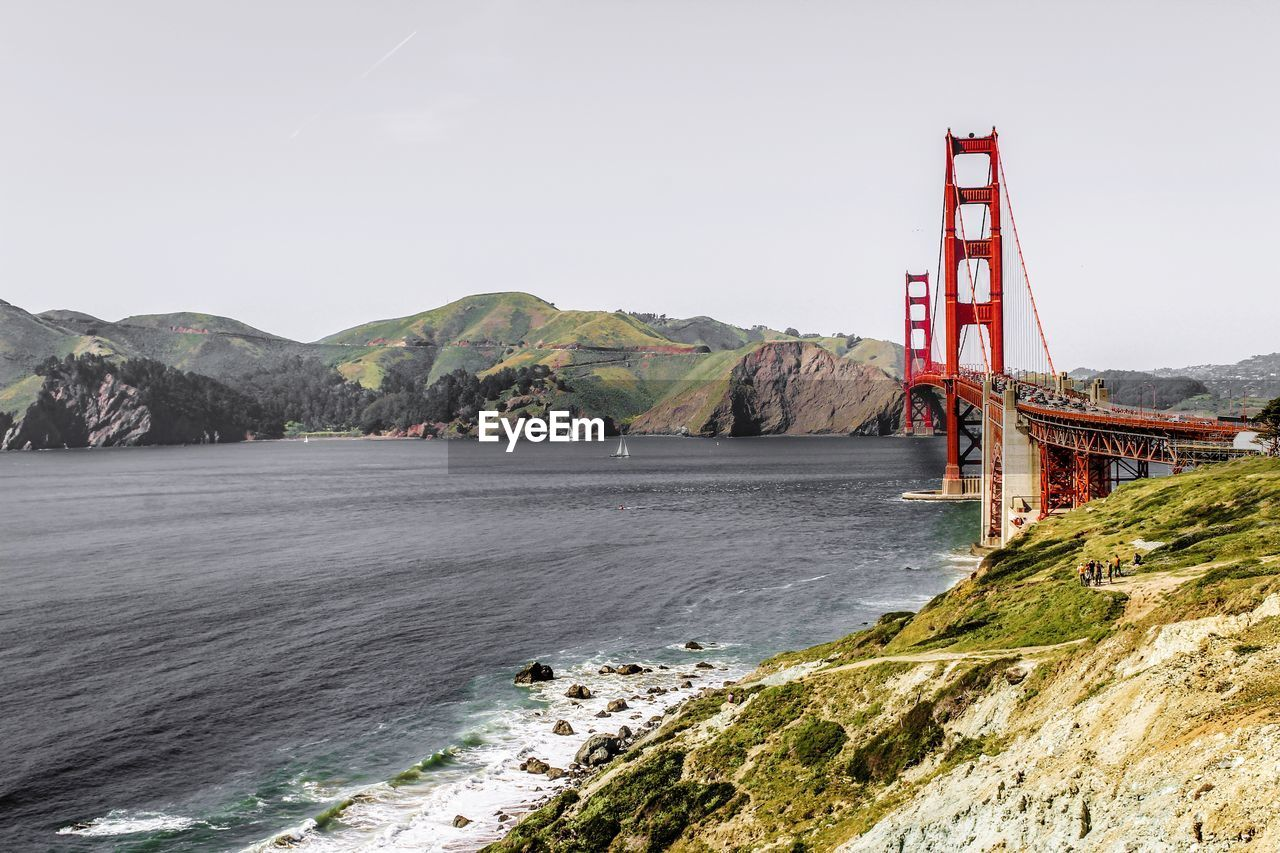 water, mountain, sky, sea, nature, bay, built structure, architecture, bridge, bridge - man made structure, beauty in nature, scenics - nature, bay of water, day, transportation, connection, travel destinations, suspension bridge, travel, mountain range, no people, outdoors