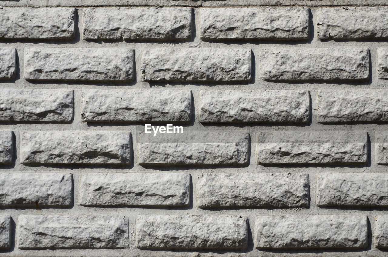 wall - building feature, architecture, wall, stone wall, built structure, brick wall, brick, full frame, no people, textured, backgrounds, pattern, close-up, in a row, rough, solid, day, stone material, building exterior, outdoors