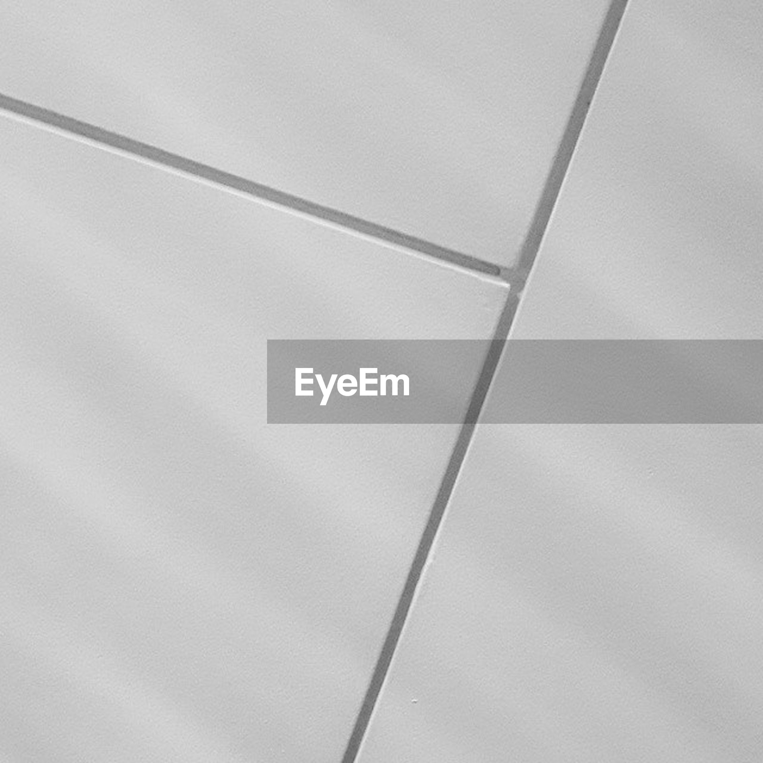 low angle view, sky, indoors, backgrounds, no people, full frame, day, part of, pattern, built structure, copy space, electricity, metal, cable, close-up, connection, white color, wall - building feature, directly below