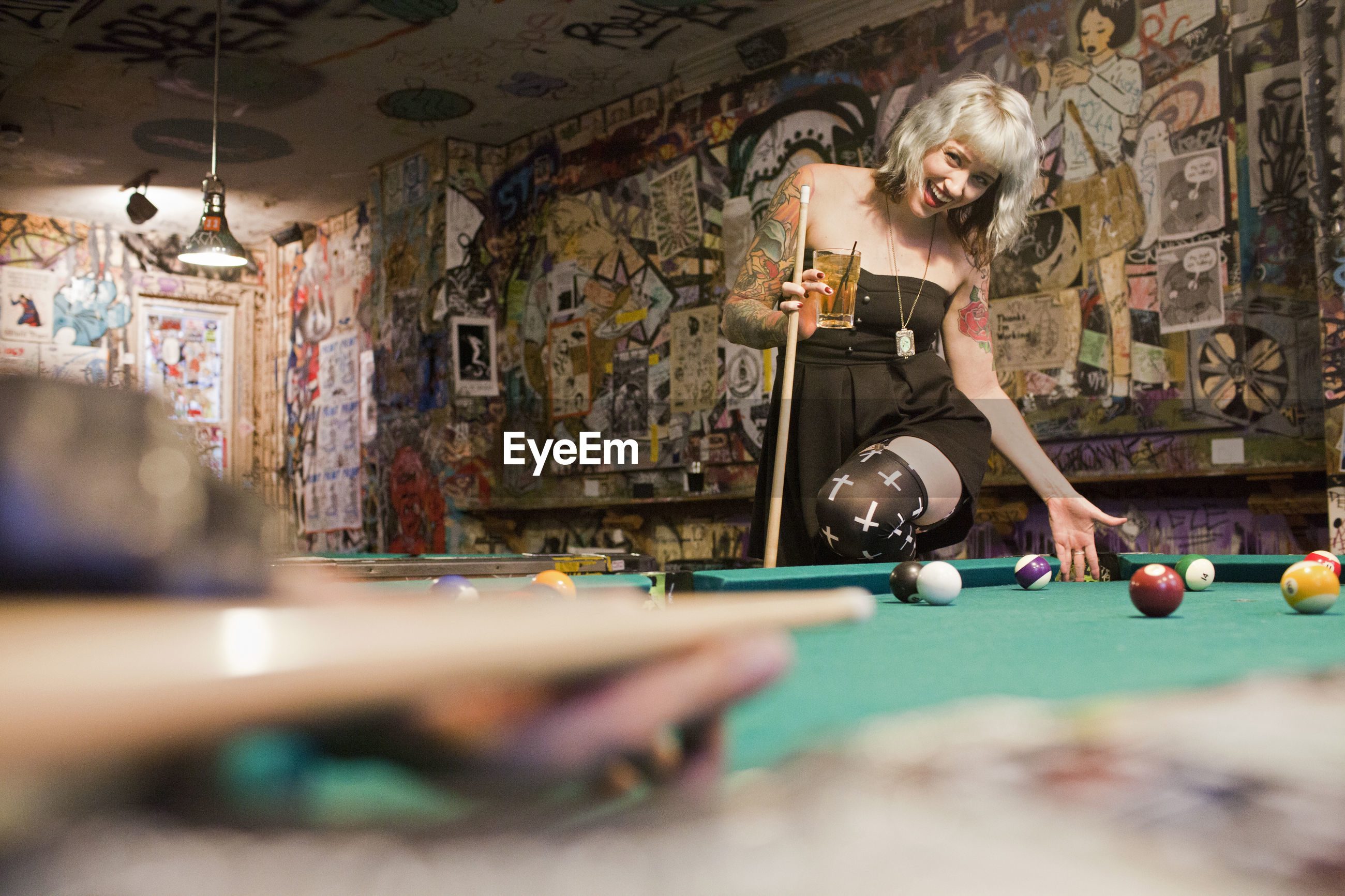 WOMAN PLAYING WITH BALL ON TABLE AT HOME