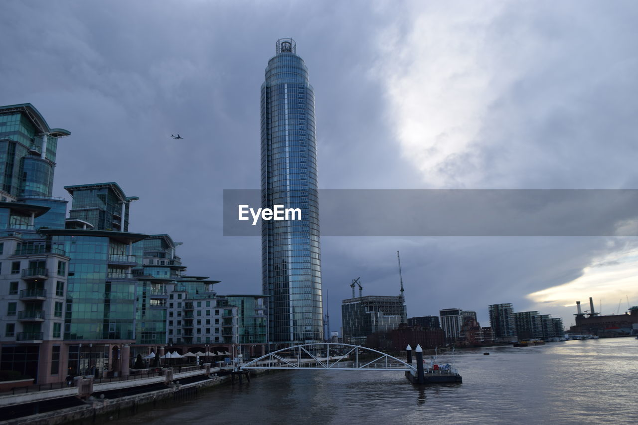 architecture, built structure, building exterior, sky, water, tall - high, cloud - sky, skyscraper, tower, city, modern, travel destinations, real people, outdoors, men, day, nature, people