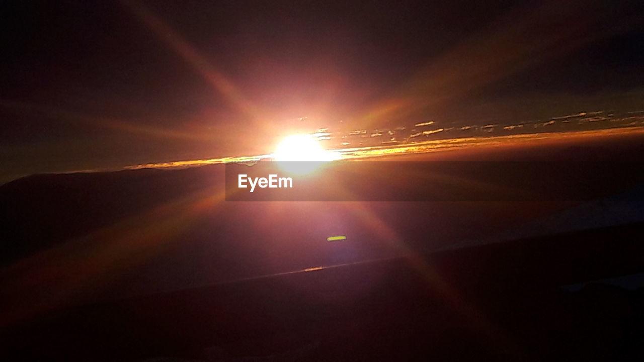 sun, sunset, nature, sunlight, sunbeam, lens flare, outdoors, sky, no people, beauty in nature, scenics, silhouette, close-up