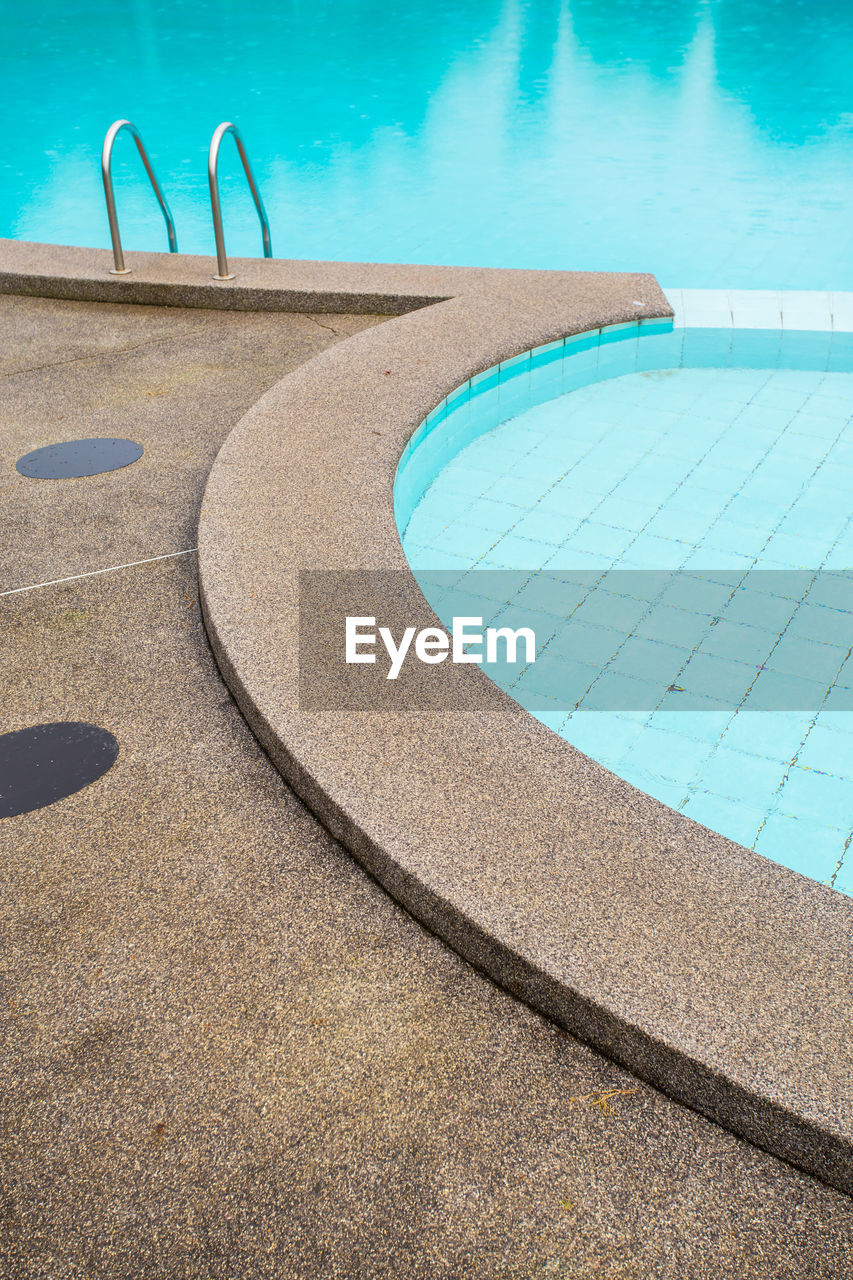 swimming pool, pool, water, poolside, high angle view, nature, day, no people, blue, sunlight, outdoors, absence, shadow, turquoise colored, tranquility, shape, summer, curve, pattern