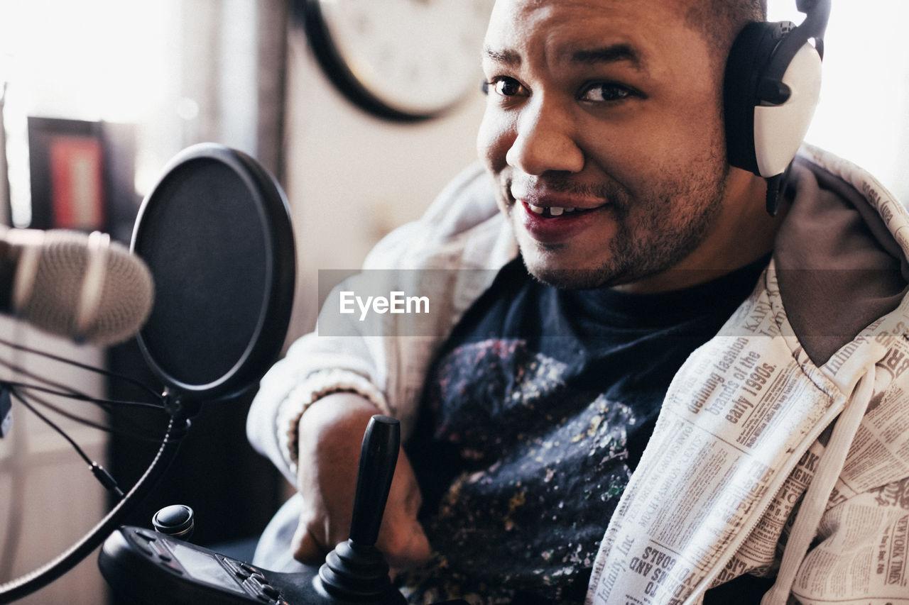 Portrait of disabled musician with headphones in studio