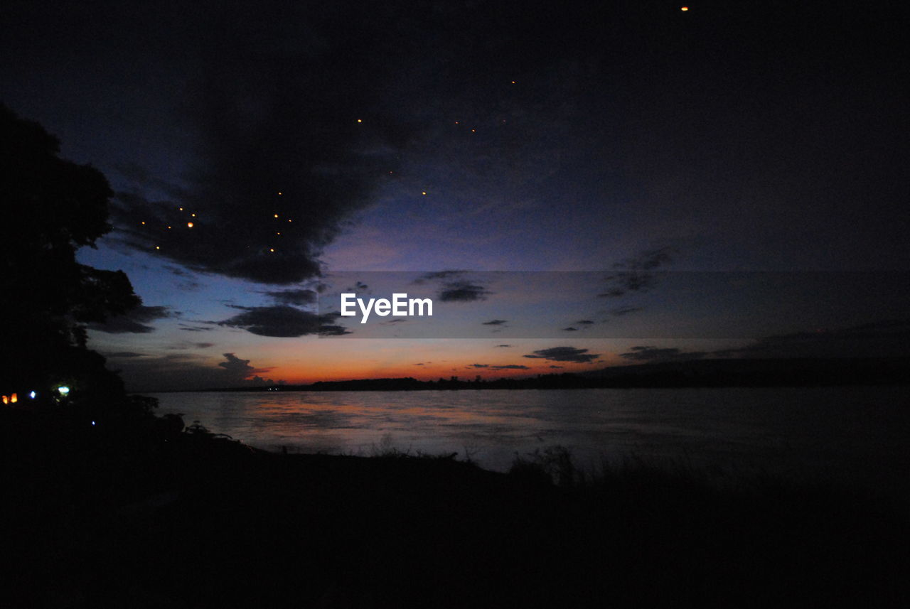 sky, silhouette, nature, tranquil scene, beauty in nature, scenics, tranquility, night, idyllic, sunset, no people, water, moon, cloud - sky, outdoors, sea, astronomy
