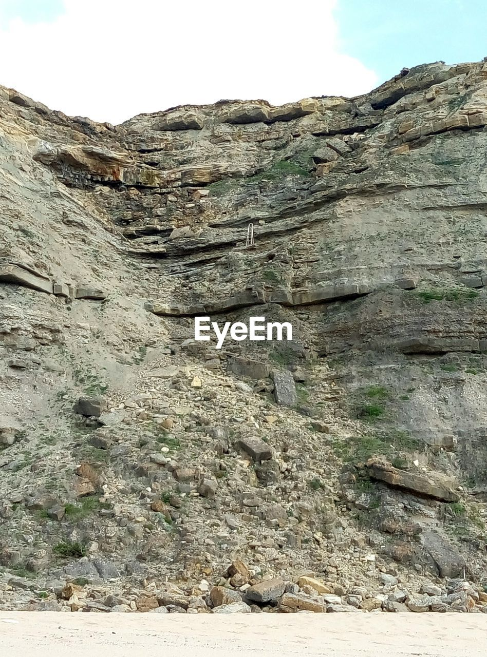 nature, rock - object, geology, rough, day, sky, no people, outdoors, textured, physical geography, low angle view, arid climate, cliff, beauty in nature, mountain