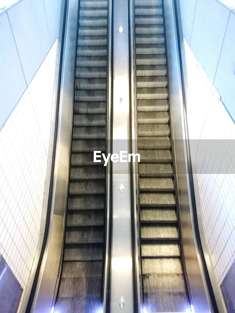 indoors, staircase, steps, steps and staircases, escalator, modern, convenience, railing, futuristic, technology, architecture, built structure, high angle view, transportation, subway station, the way forward, no people, day