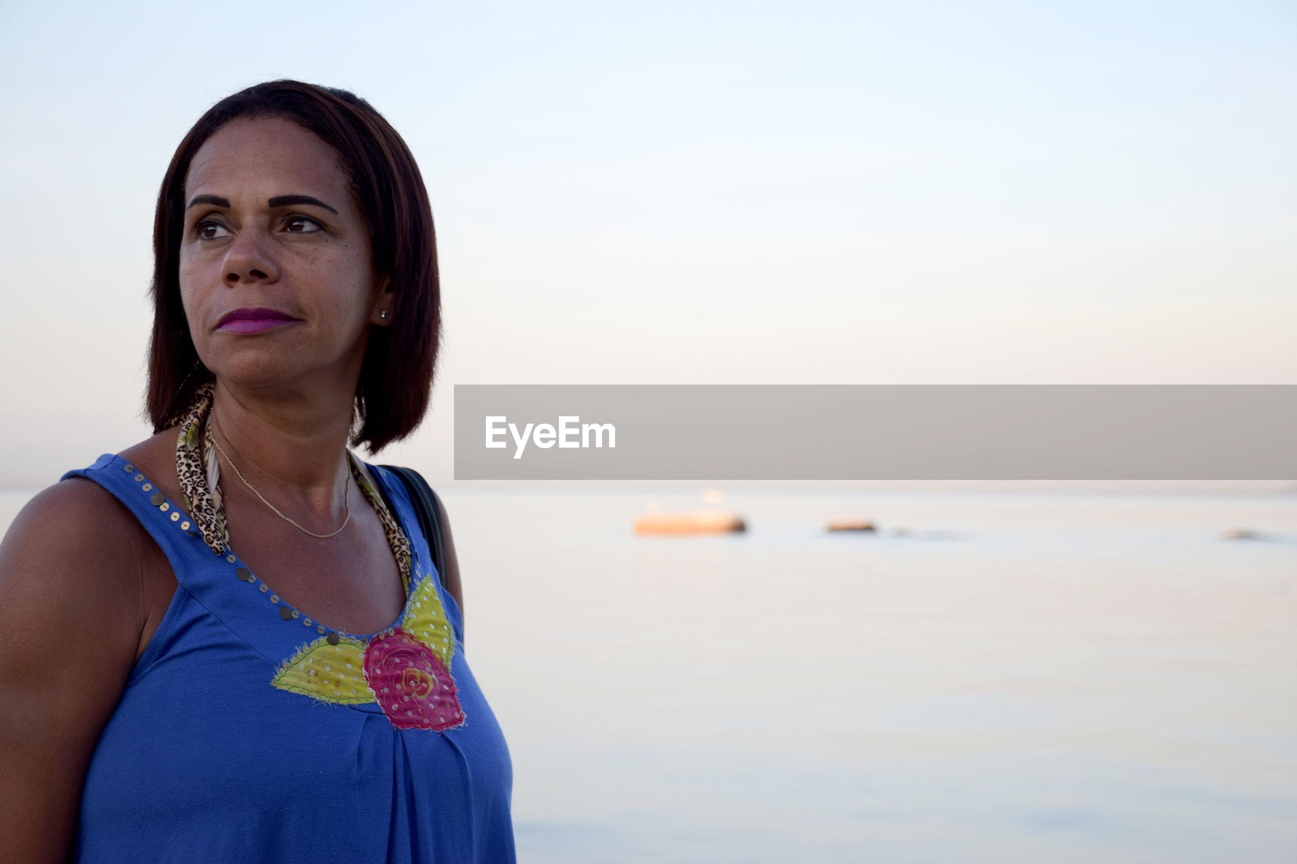 Mature woman against sea at beach