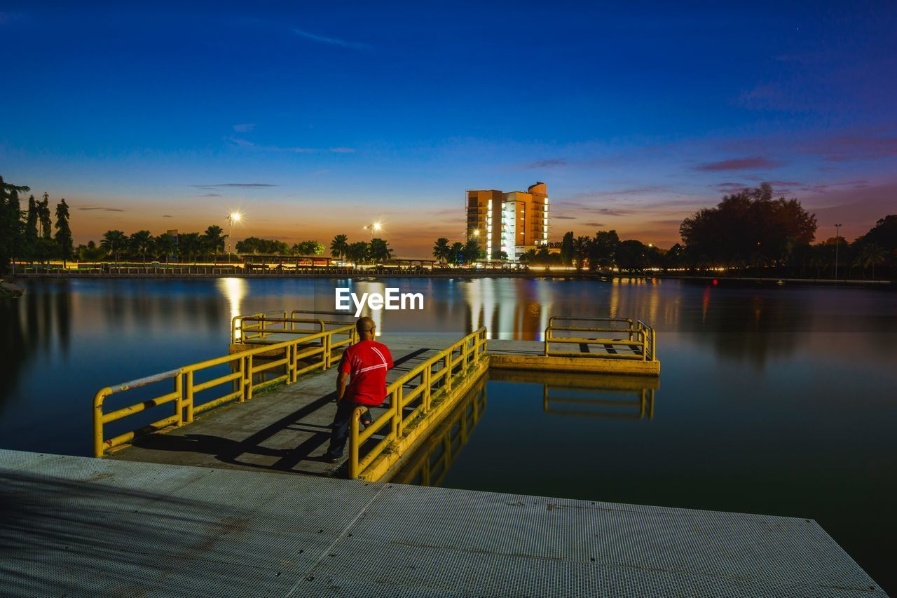 built structure, water, architecture, sky, building exterior, reflection, river, sunset, illuminated, cloud - sky, outdoors, city, no people, skyscraper, tree, night, urban skyline, nature, nautical vessel, beauty in nature, cityscape