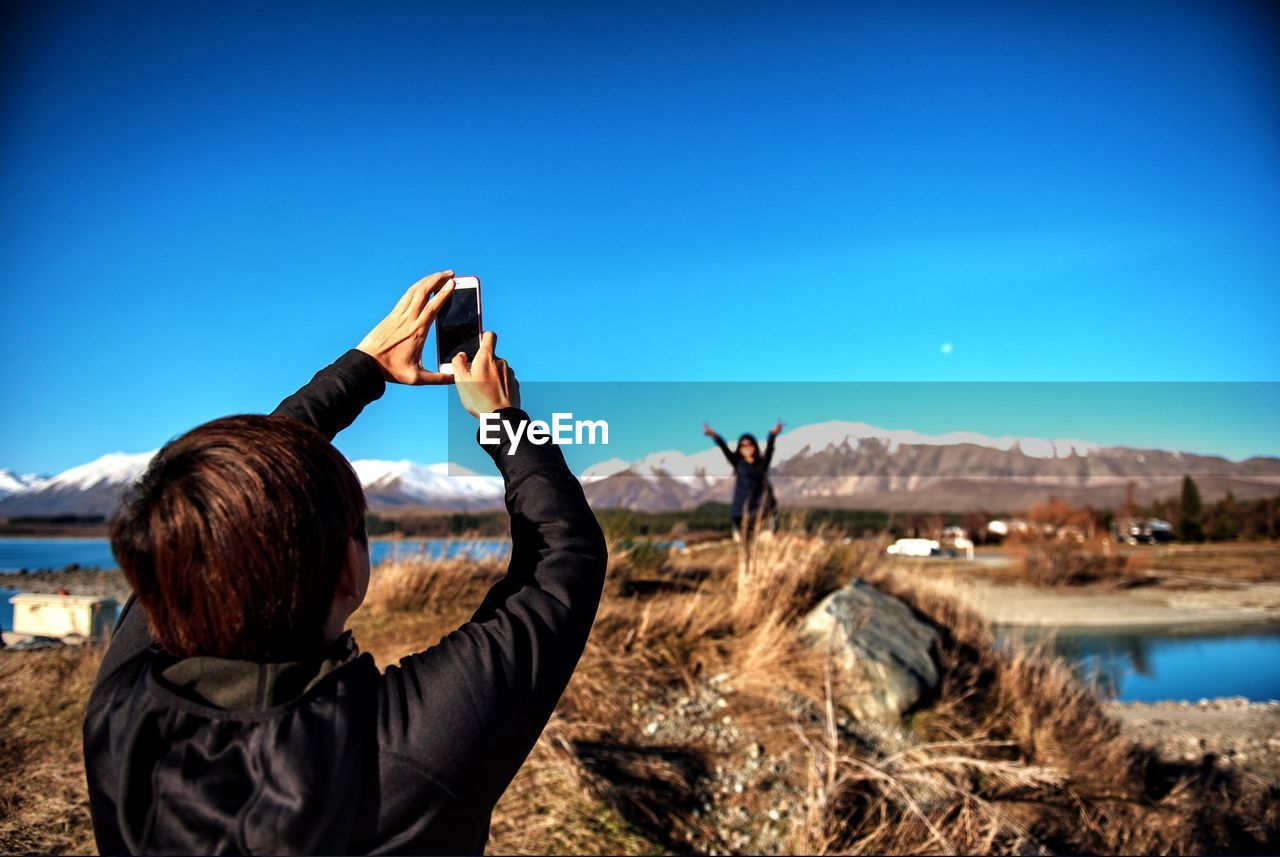 Man Photographing With Smart Phone