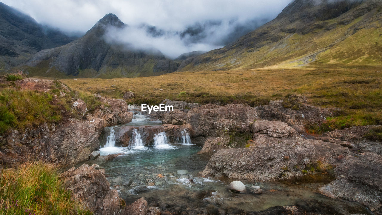 Scenic View Of Stream On Landscape