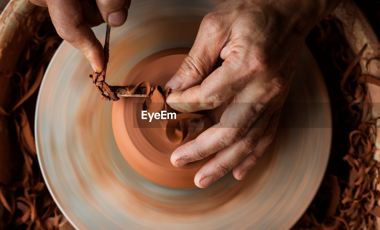 Cropped Image Of Making Earthenware