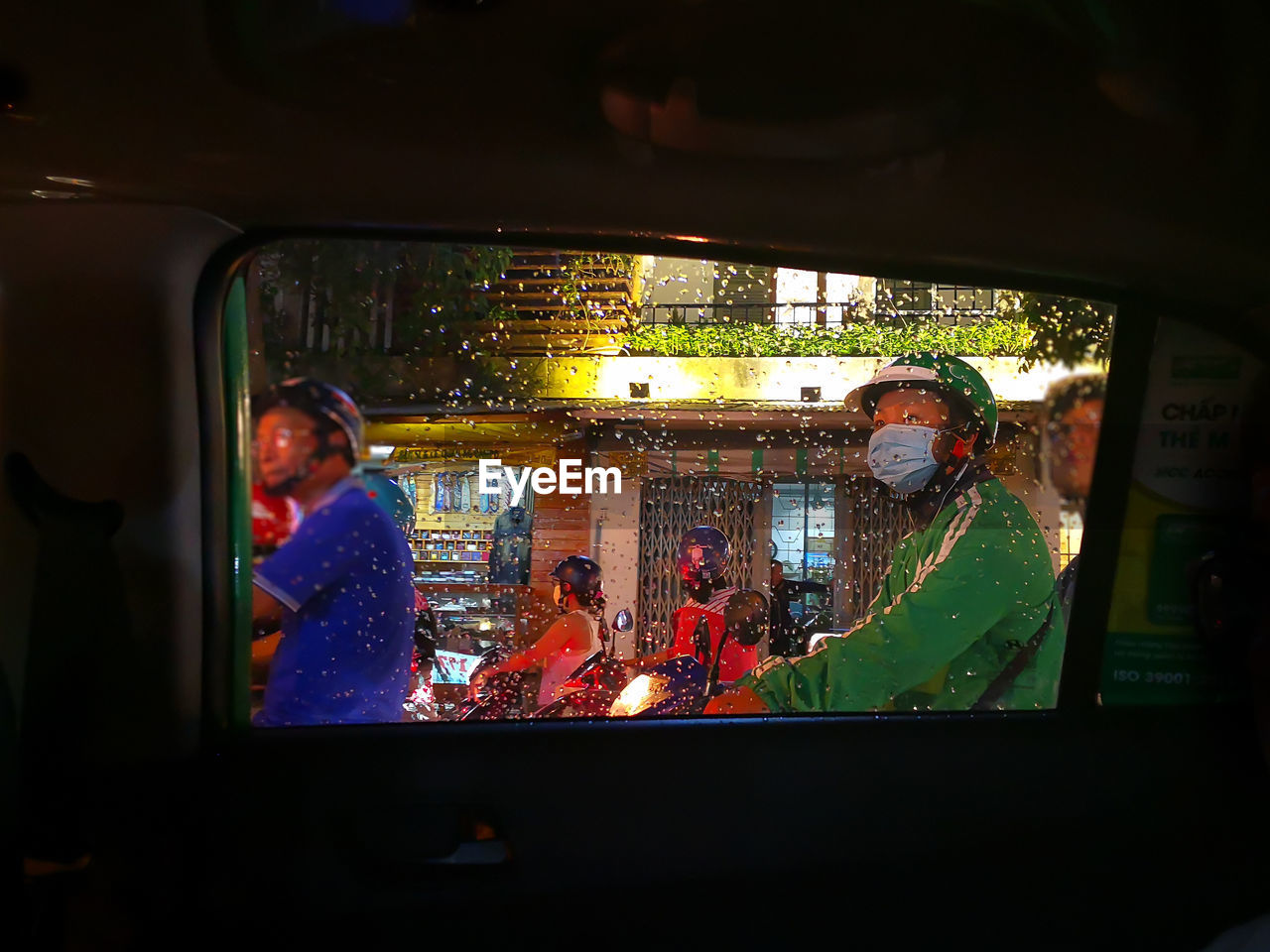 window, real people, night, looking through window, illuminated, lifestyles, indoors, men, togetherness, sitting, childhood, women, people