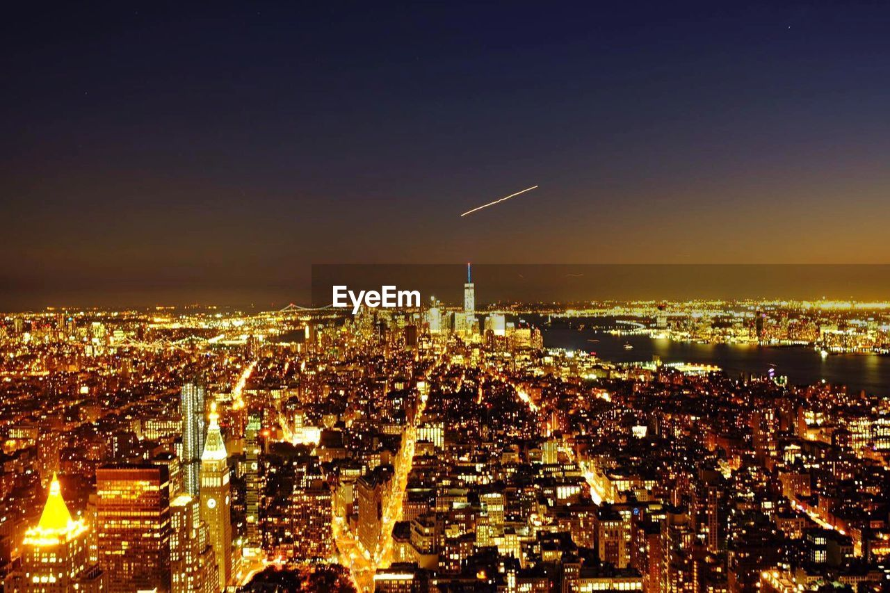 AERIAL VIEW OF ILLUMINATED CITYSCAPE