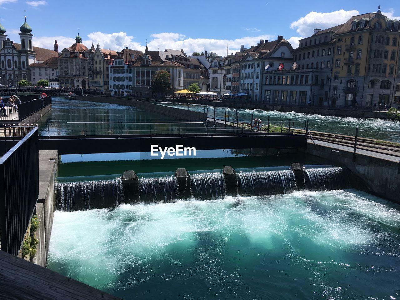water, architecture, built structure, building exterior, nature, motion, sky, day, no people, dam, city, waterfront, flowing water, hydroelectric power, river, building, beauty in nature, outdoors, splashing, flowing, power in nature, swimming pool