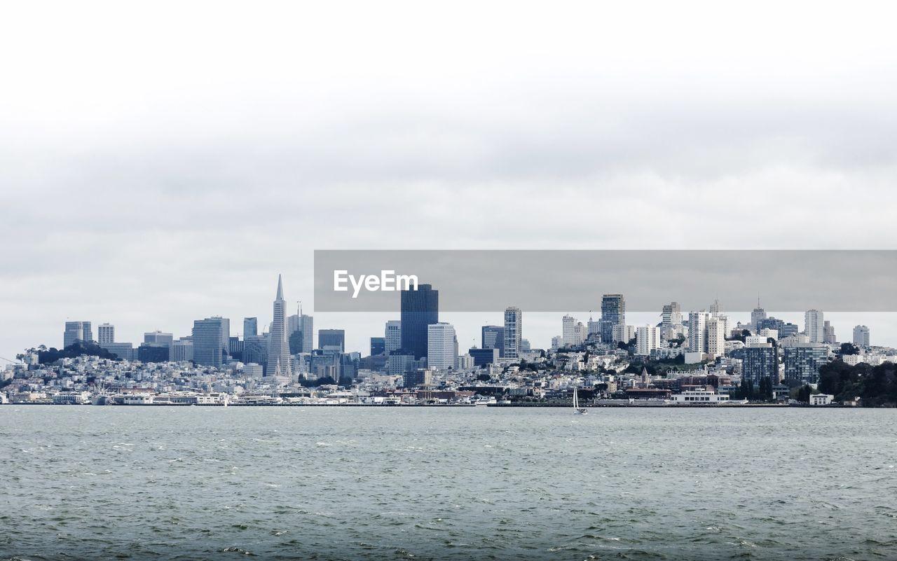 Modern Cityscape And Sea Against Sky