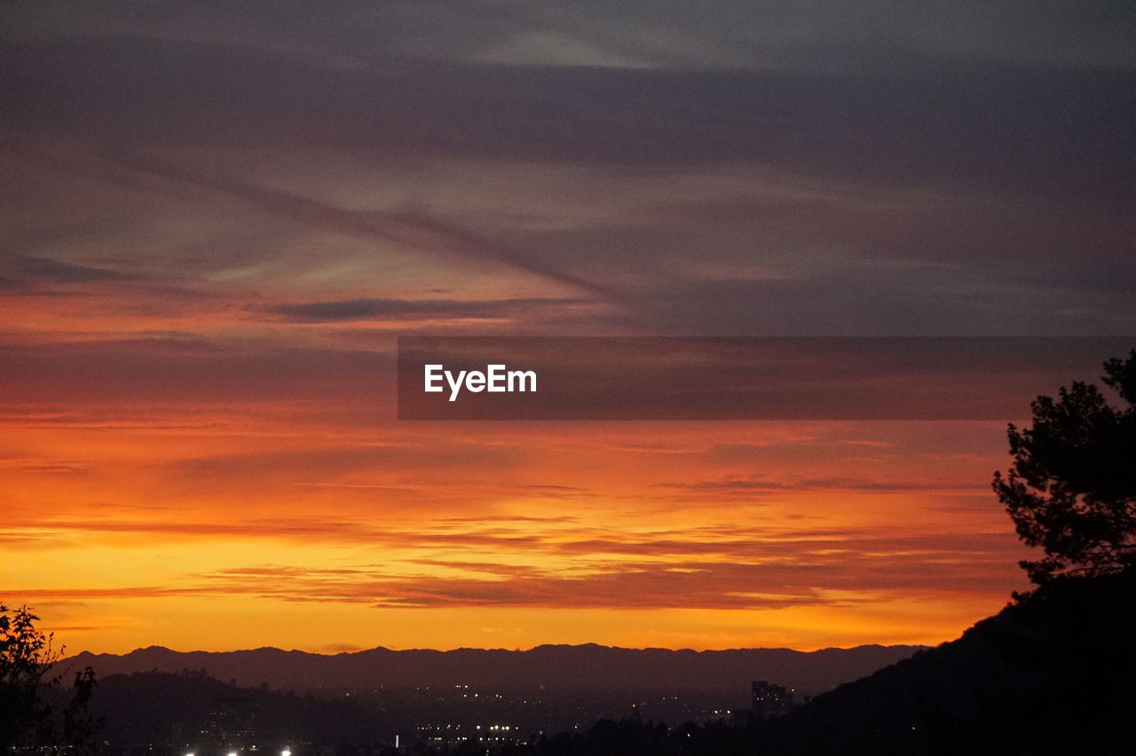 sunset, sky, silhouette, nature, beauty in nature, orange color, scenics, cloud - sky, dramatic sky, no people, tranquil scene, tree, tranquility, outdoors, mountain, day