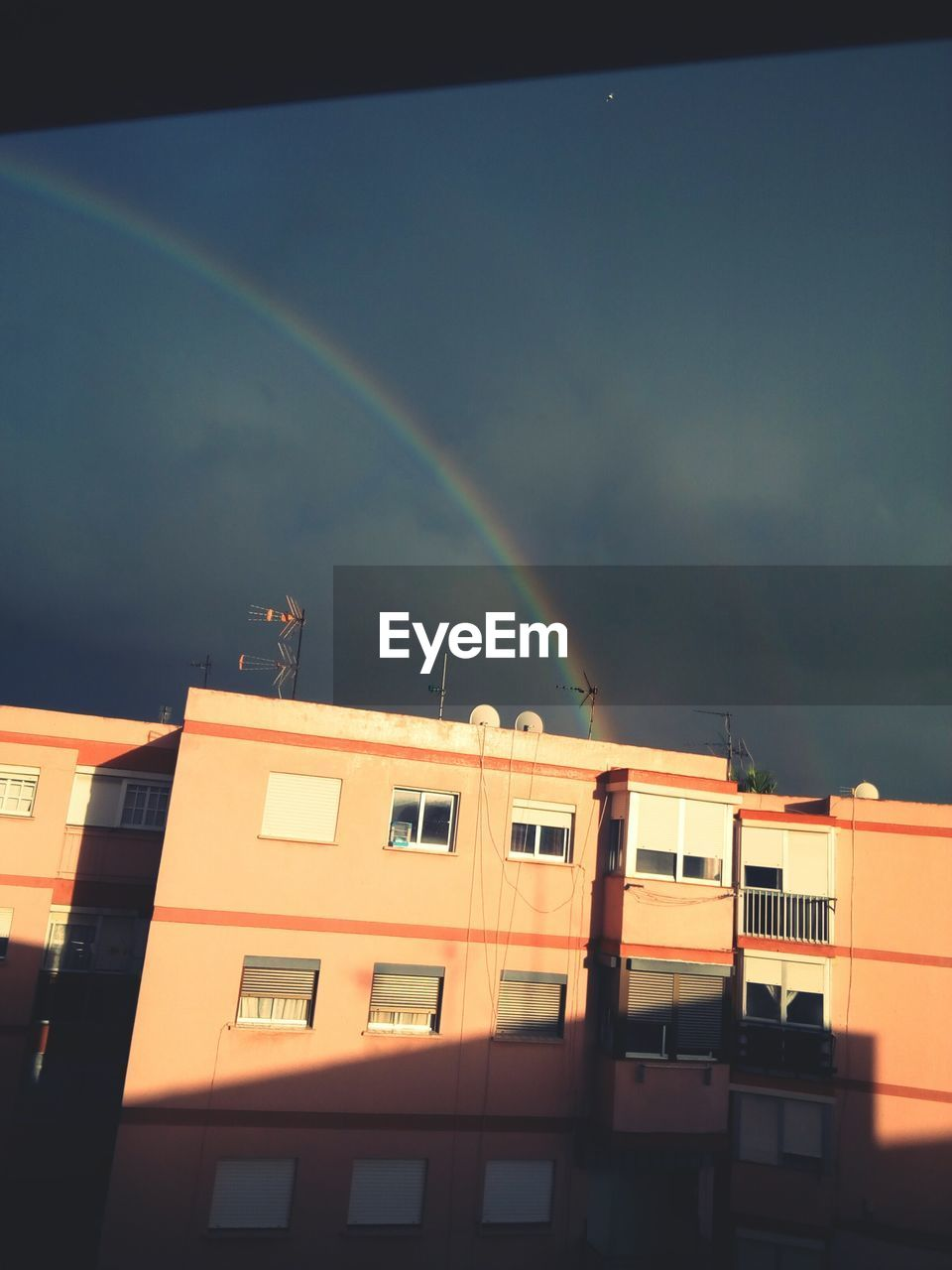 building exterior, architecture, rainbow, no people, built structure, window, outdoors, residential building, sky, day, nature, city