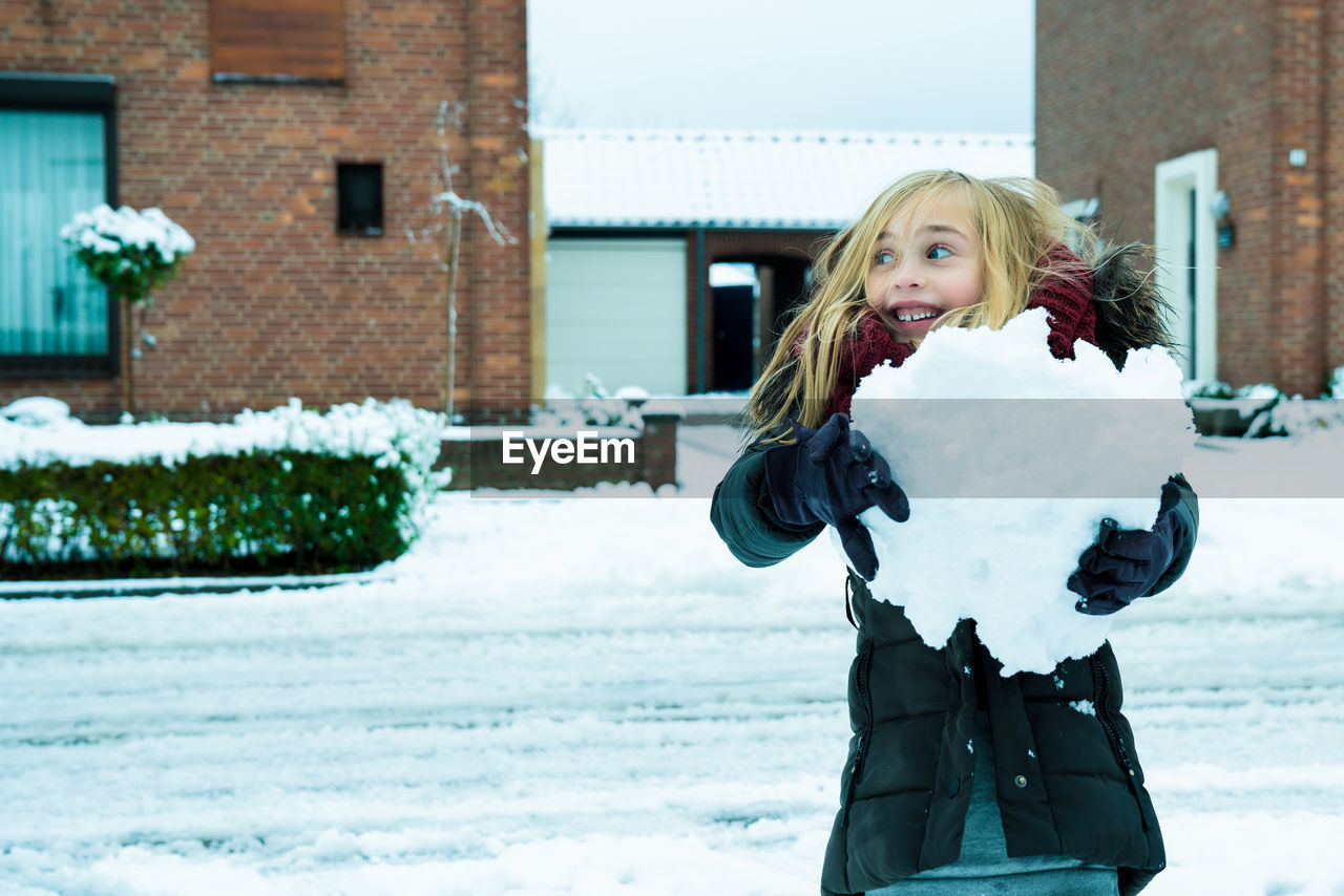 Close-Up Of Girl Playing In Snow