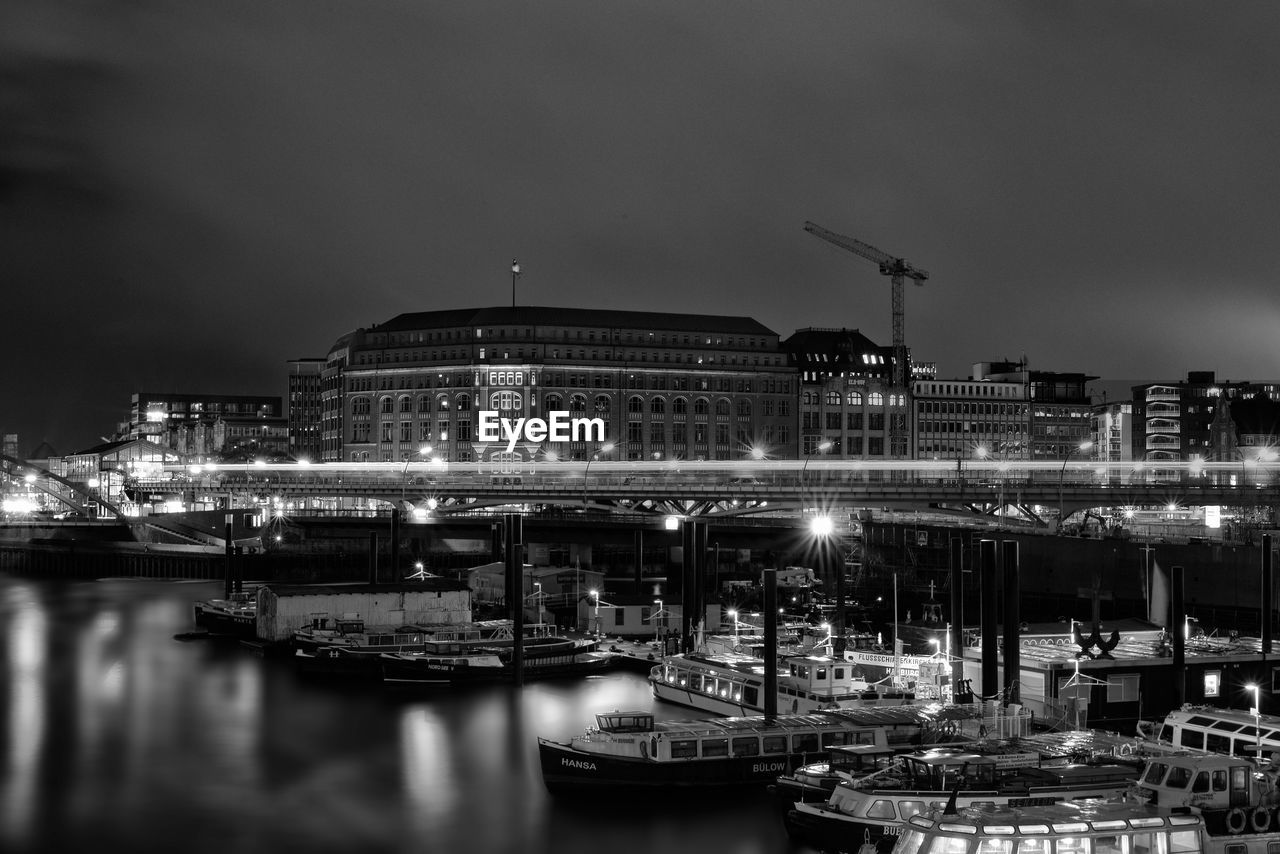 architecture, built structure, night, illuminated, water, nautical vessel, sky, building exterior, transportation, river, waterfront, no people, outdoors, mode of transport, moored, harbor, travel destinations, city, nature