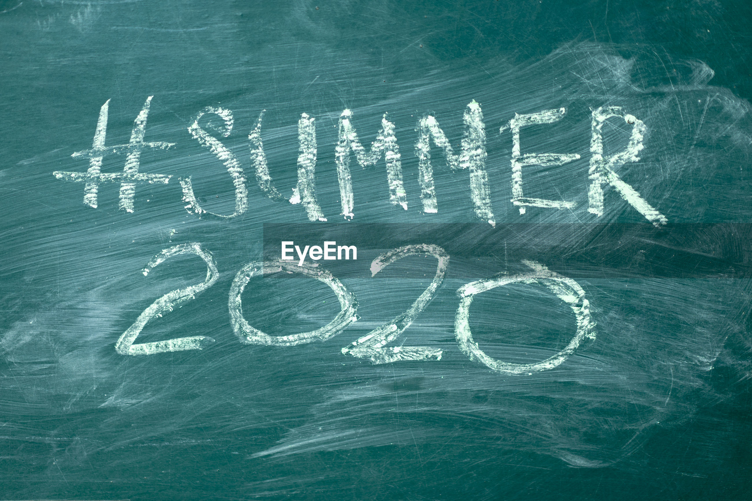 Close-up of hashtag and summer 2020 on blackboard