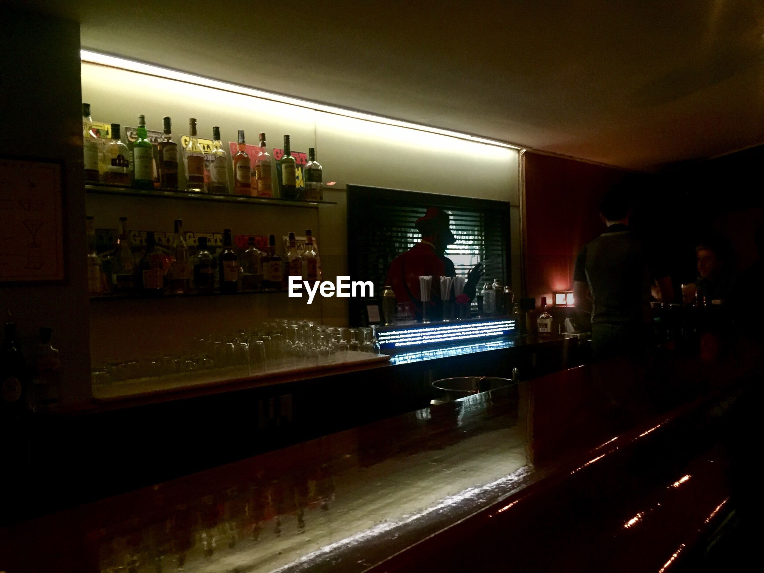indoors, bar counter, bar - drink establishment, alcohol, illuminated, shelf, food and drink, bottle, night, drink, cocktail, no people