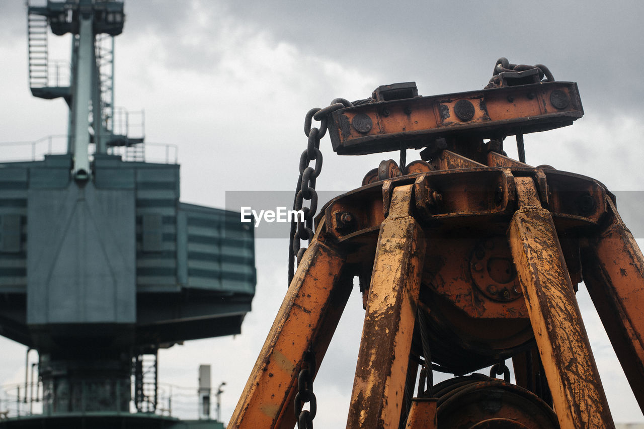 Machinery against sky