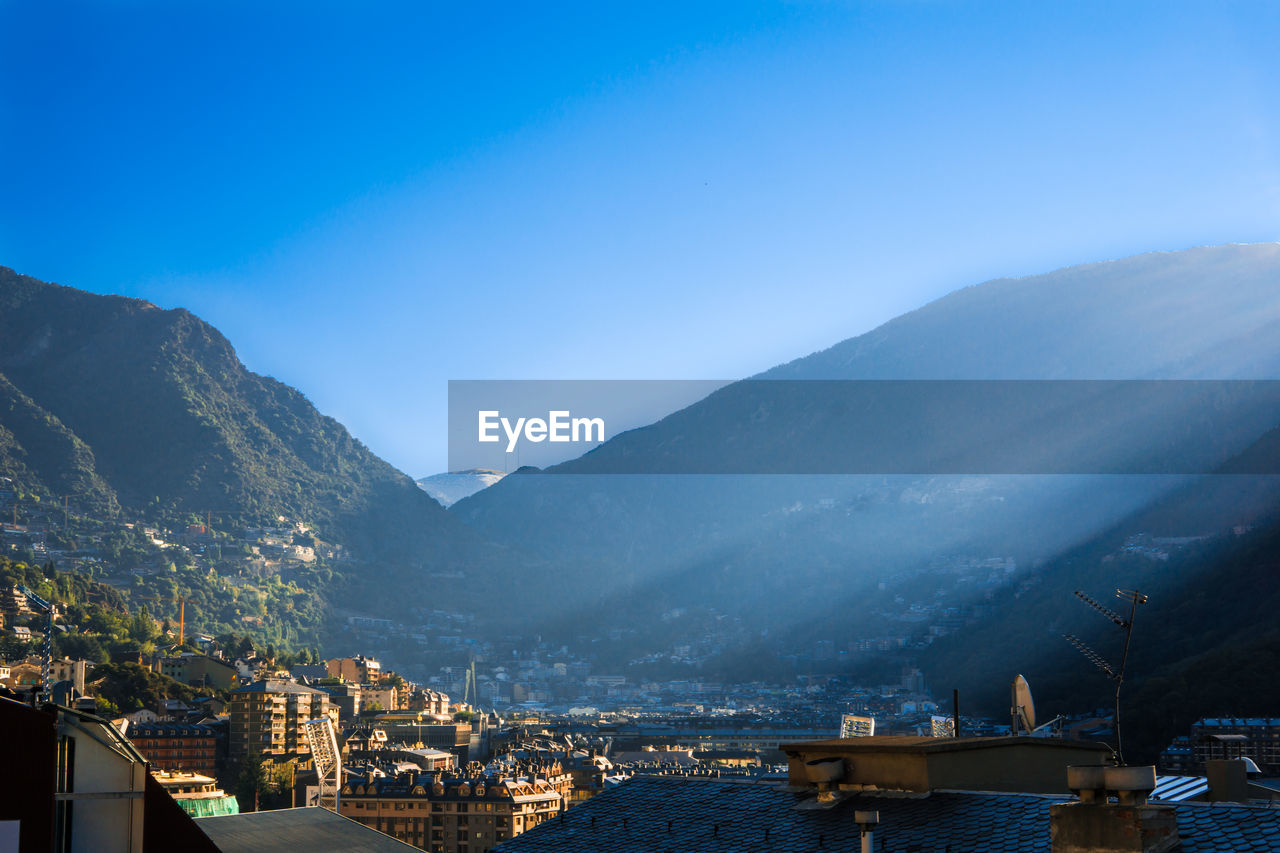 Town in the pyrenees mountains against clear blue sky