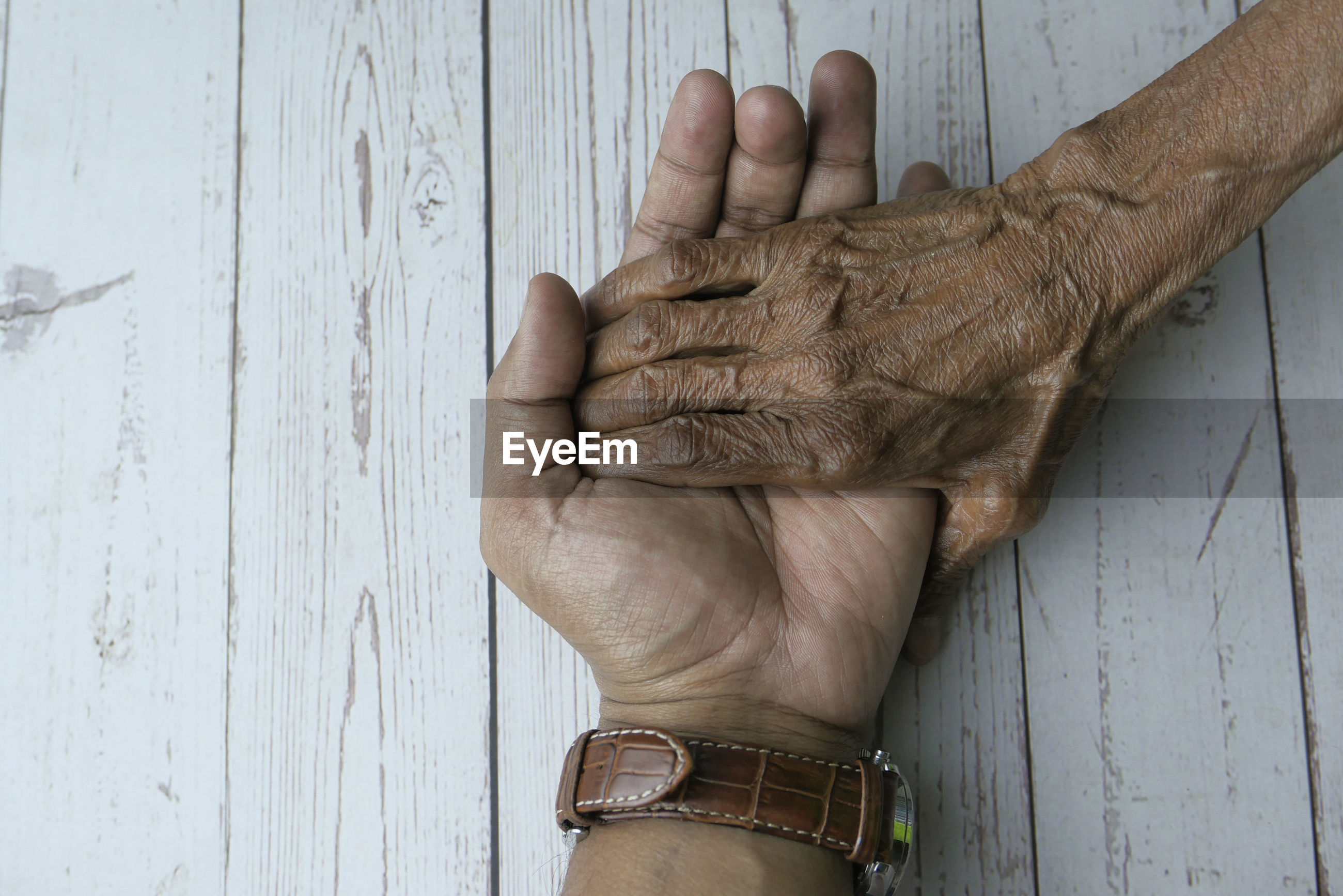 Holding hand of senior women