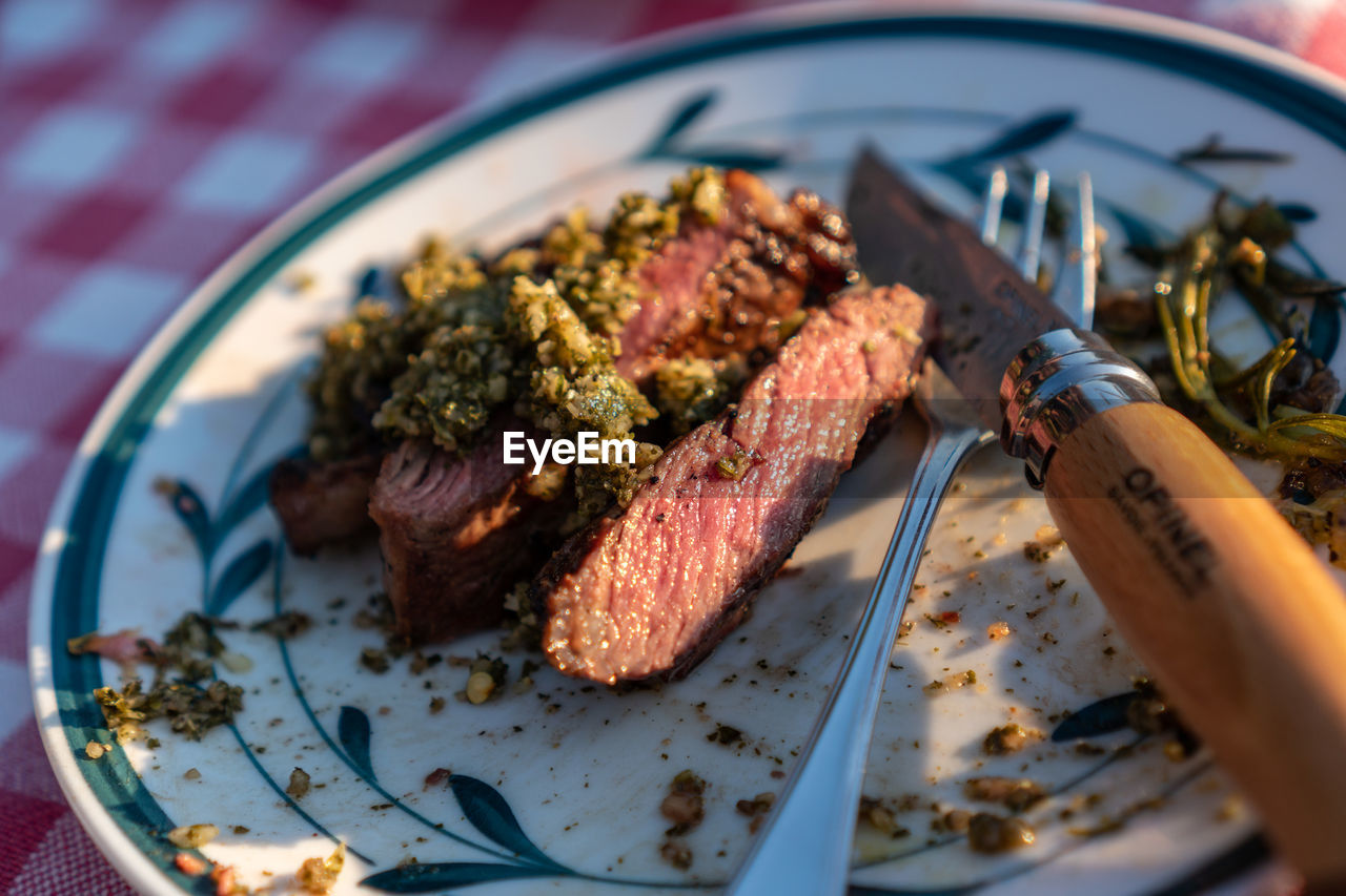 food and drink, food, meat, indoors, close-up, freshness, still life, selective focus, ready-to-eat, plate, wellbeing, eating utensil, no people, healthy eating, kitchen utensil, fork, table, meal, red meat, indulgence, table knife, dinner, temptation