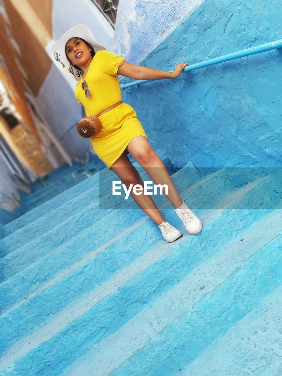 HIGH ANGLE VIEW OF WOMAN IN POOL