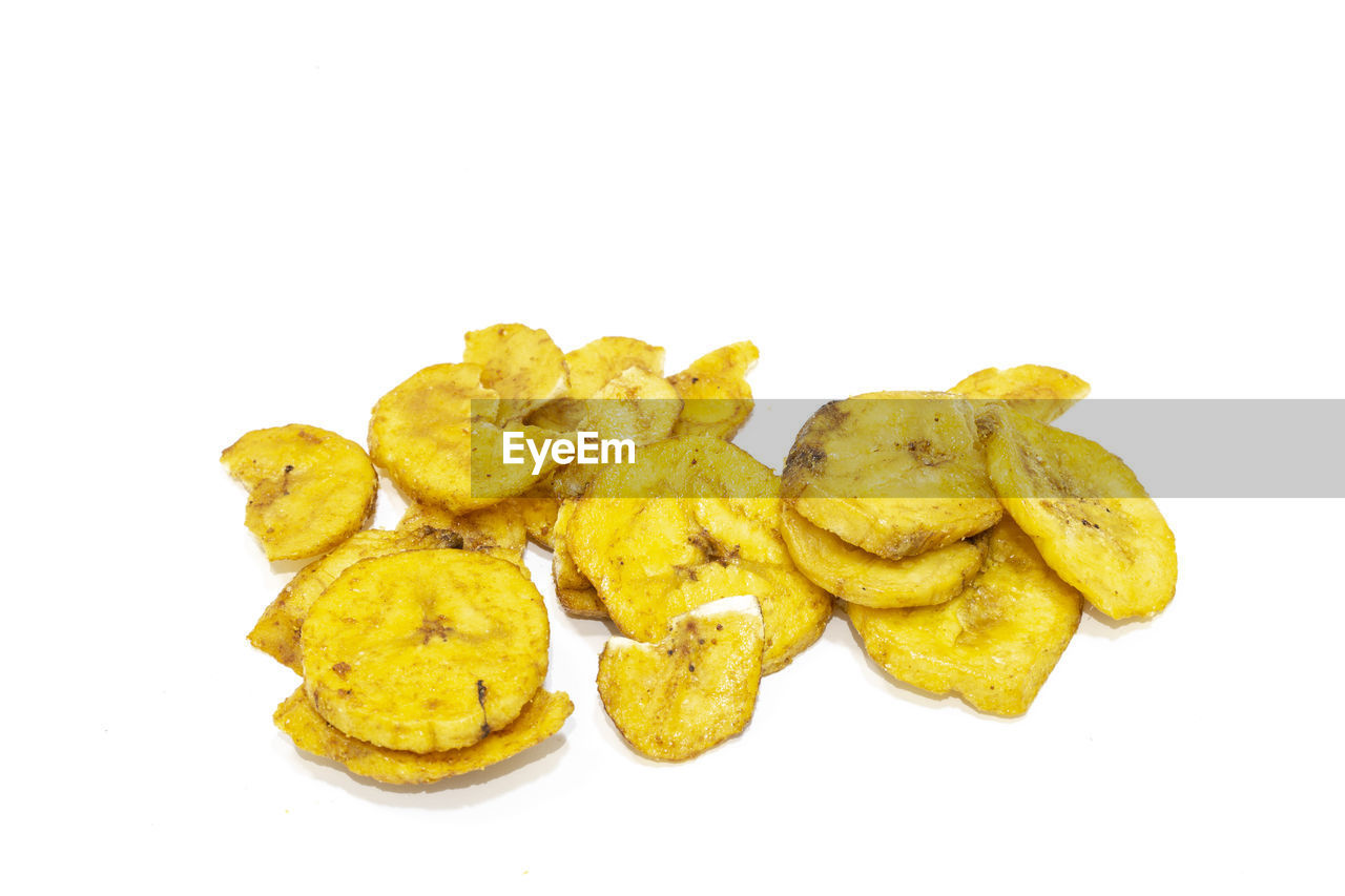 white background, studio shot, still life, food and drink, indoors, copy space, yellow, food, freshness, cut out, close-up, no people, group of objects, snack, unhealthy eating, ready-to-eat, potato, group, prepared potato, fried, temptation
