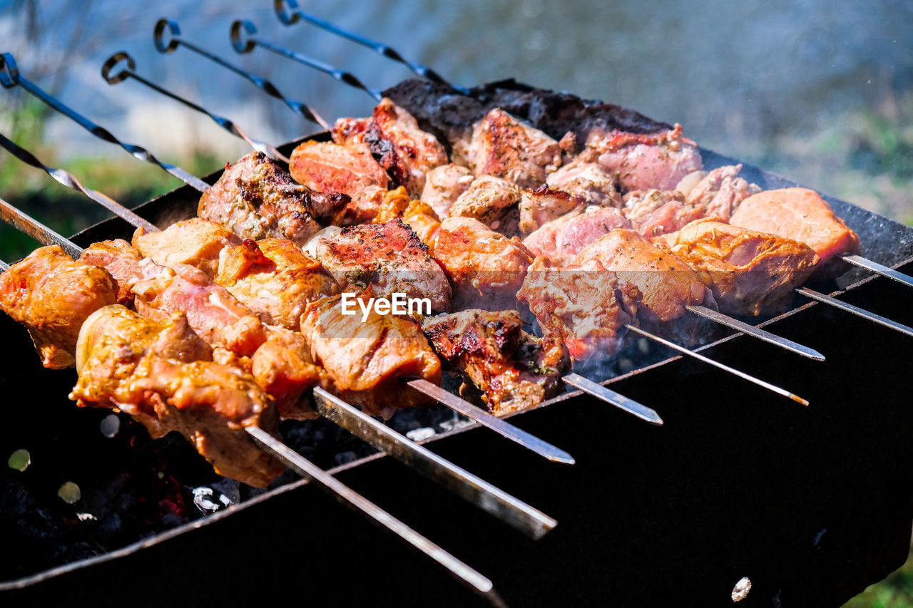 Meat is fried on coals. camping, barbecue on the grill. selective focus. fried meat on charcoal bbq