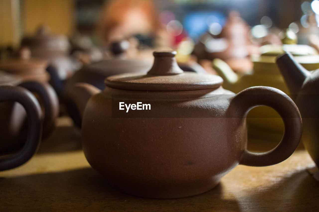 Close-up of teapot on table for sale in store