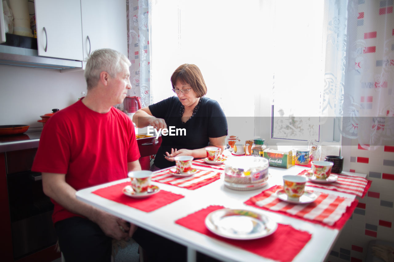 PEOPLE SITTING AT TABLE