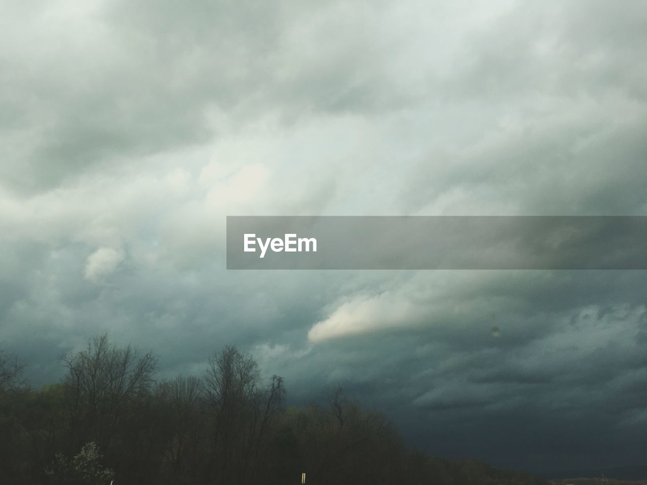 nature, beauty in nature, tranquility, cloud - sky, sky, scenics, weather, tranquil scene, tree, no people, outdoors, low angle view, day, storm cloud