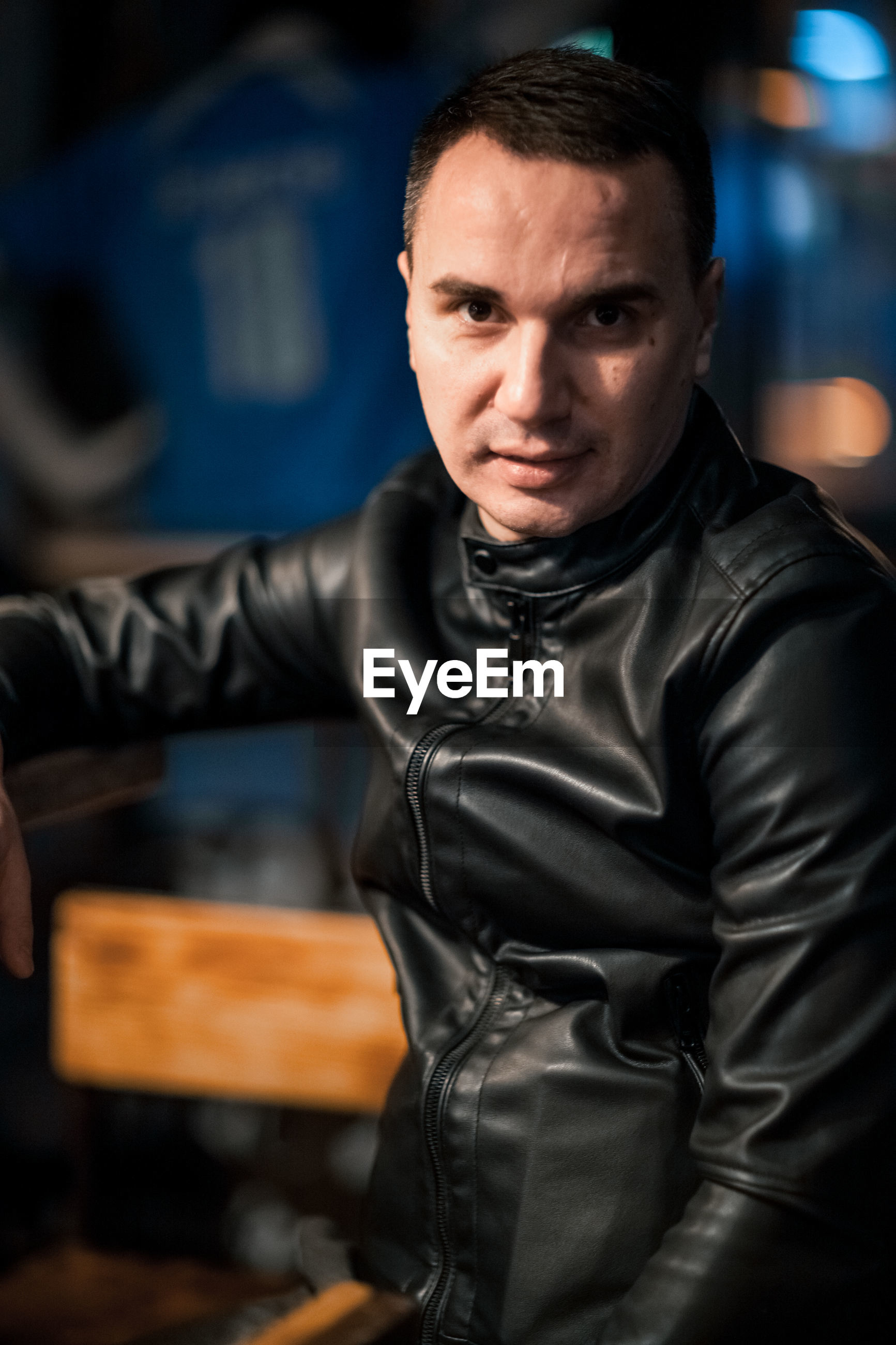 Portrait of man wearing leather jacket