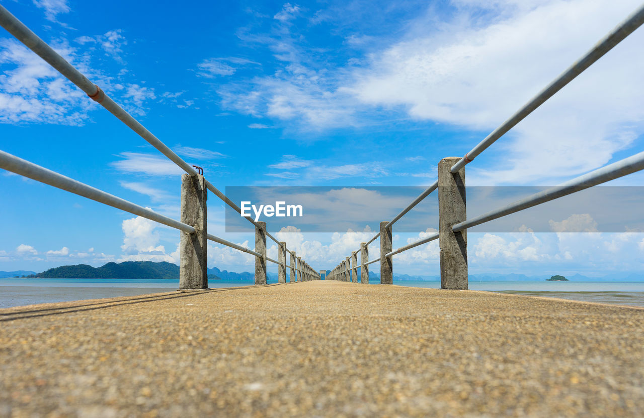 sky, cloud - sky, land, nature, beach, tranquil scene, scenics - nature, day, water, tranquility, connection, no people, bridge, sea, blue, beauty in nature, bridge - man made structure, sand, built structure, outdoors, surface level