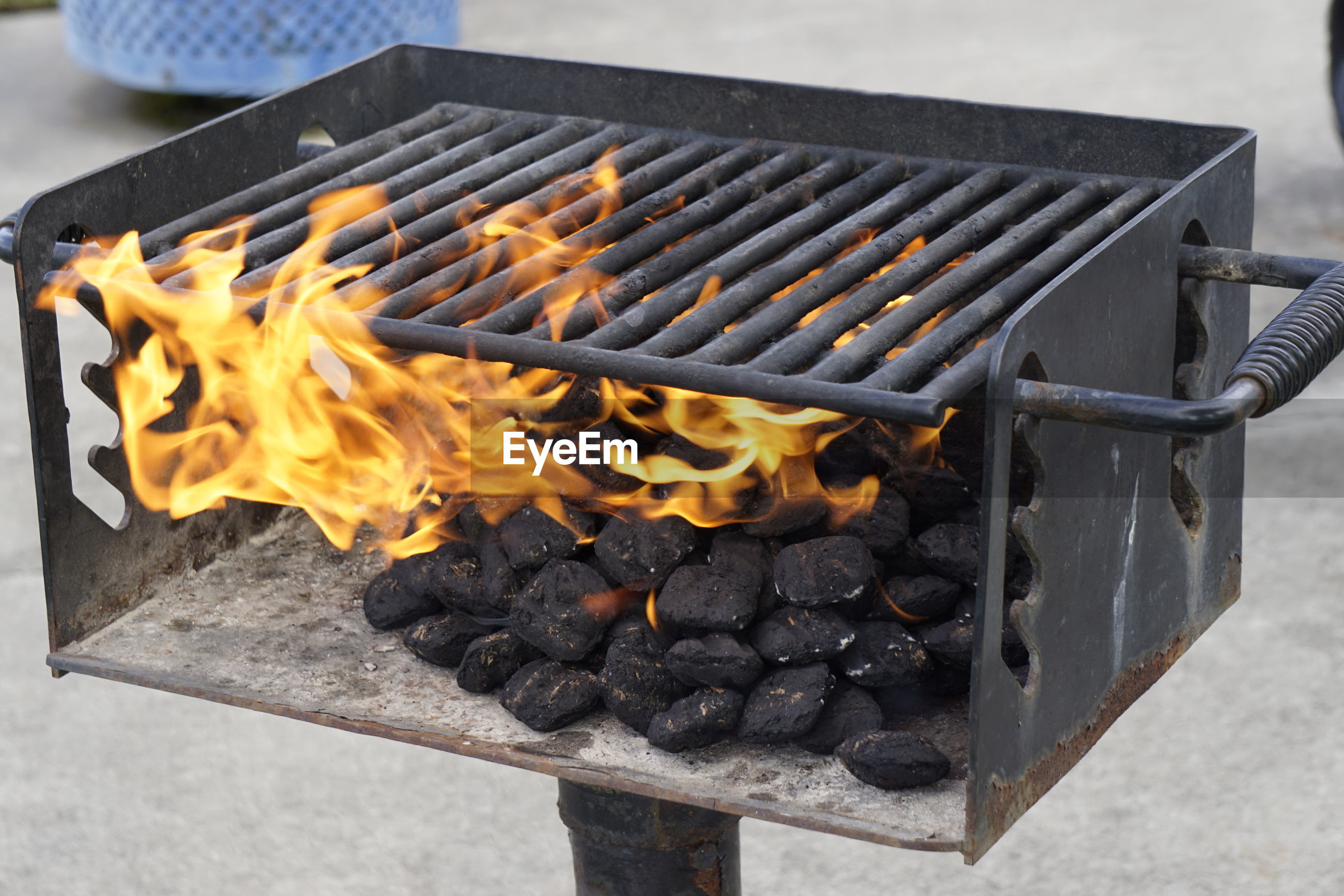Coal burning in barbecue on ground