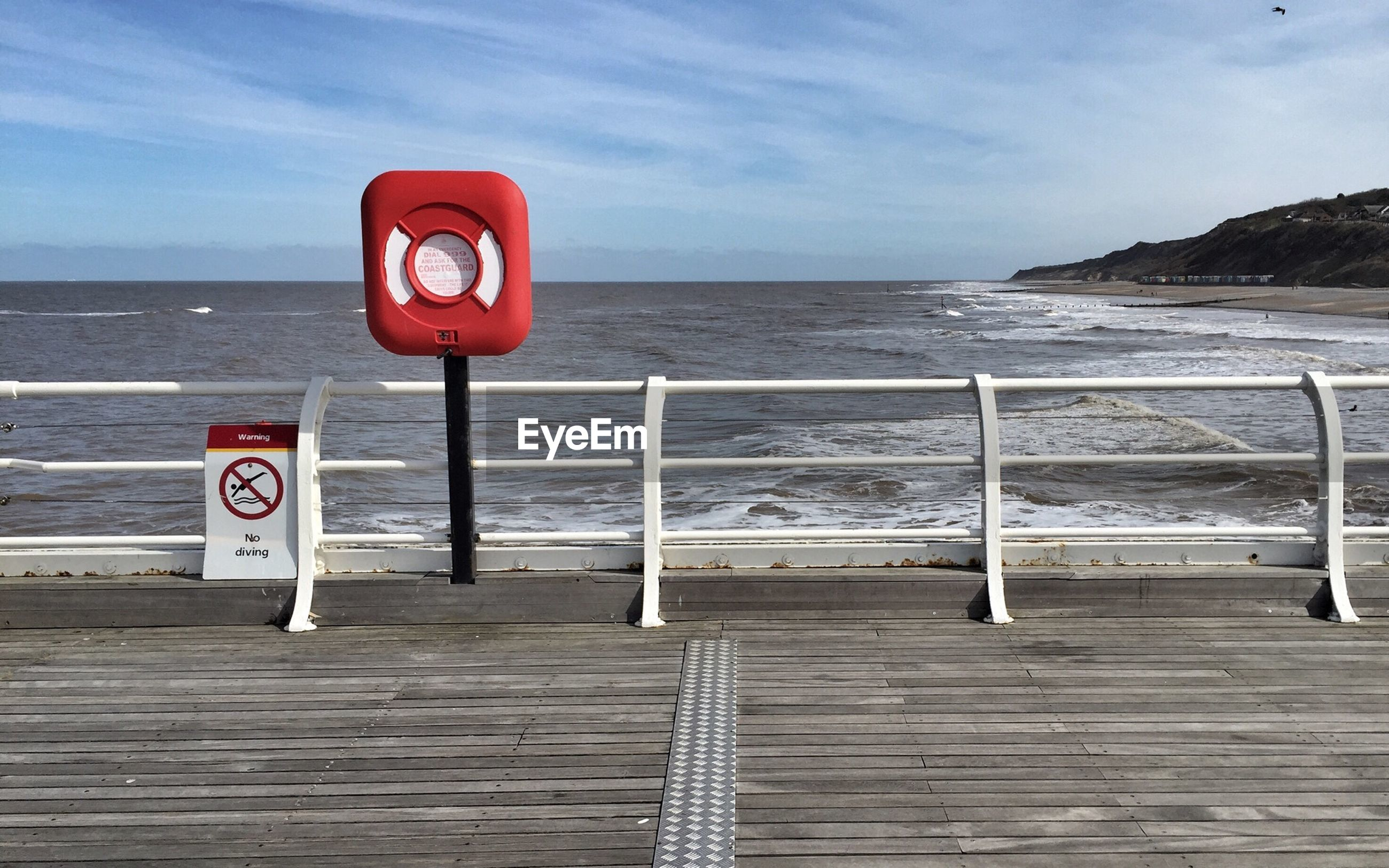 sea, horizon over water, text, water, western script, communication, sky, beach, sign, warning sign, information sign, guidance, red, shore, tranquility, tranquil scene, sand, safety, road sign, nature