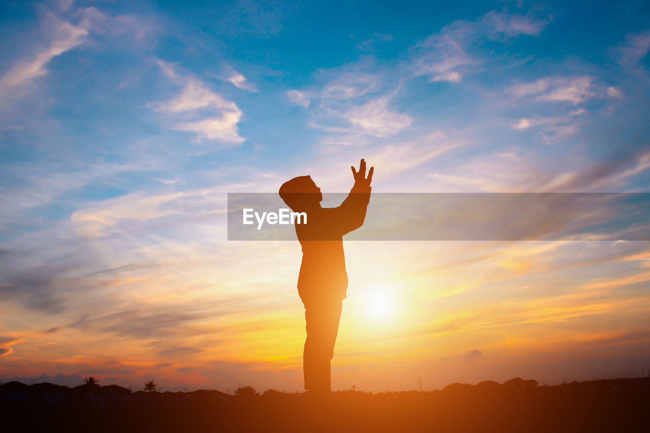 sunset, sky, one person, real people, silhouette, lifestyles, leisure activity, cloud - sky, orange color, beauty in nature, standing, scenics - nature, human arm, nature, arms raised, tranquil scene, tranquility, outdoors, men