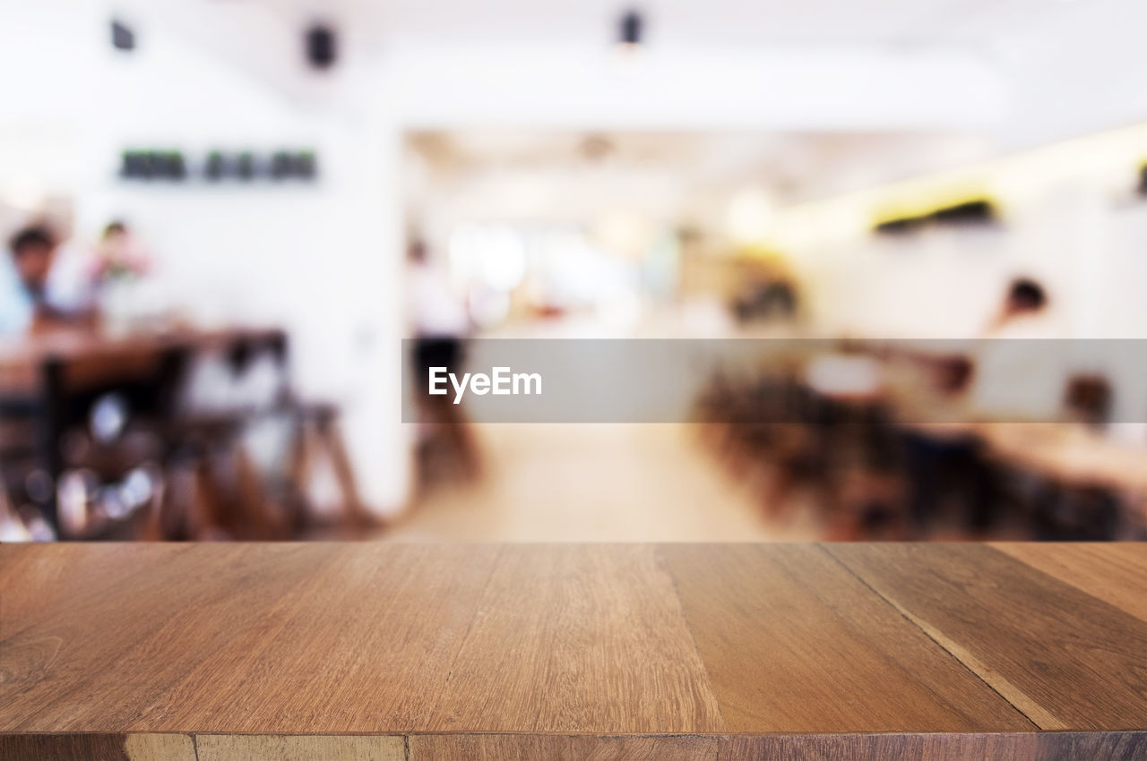 wood - material, indoors, focus on foreground, group of people, table, incidental people, selective focus, day, education, real people, close-up, adult, transportation, seat, school, flooring, brown, women, men