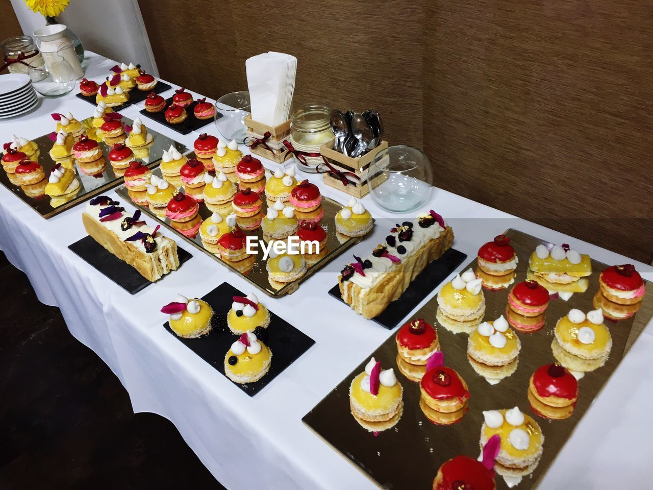 High Angle View Of Desserts Arranged On Table