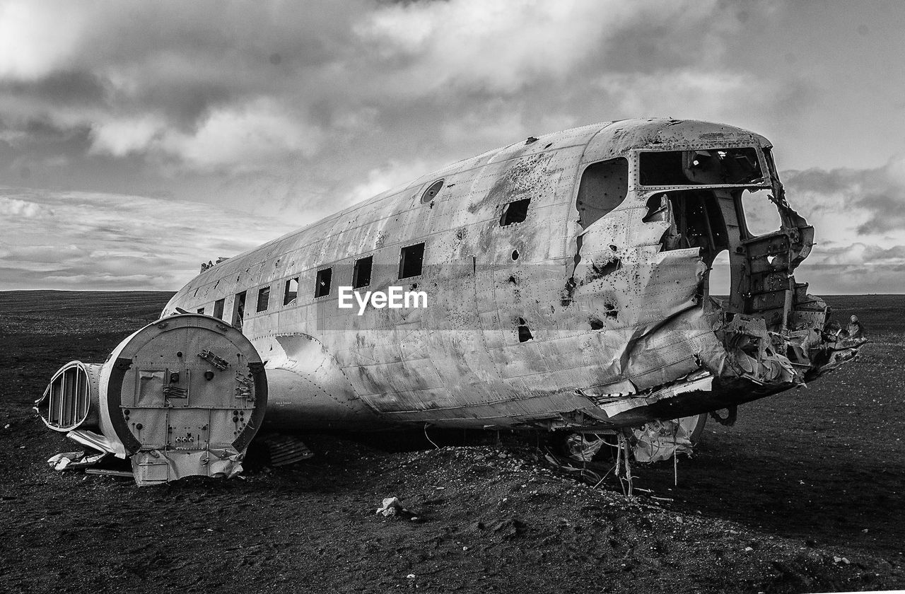 air vehicle, abandoned, airplane, land, sky, cloud - sky, mode of transportation, obsolete, damaged, nature, transportation, run-down, beach, deterioration, decline, crash, travel, day, old, broken, ruined, no people, outdoors, navy