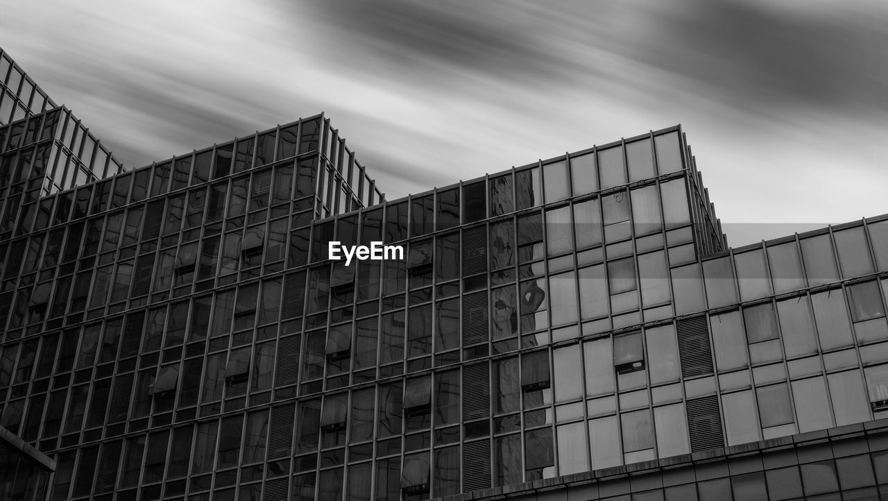 architecture, built structure, building exterior, low angle view, no people, cloud - sky, sky, building, day, city, nature, glass - material, outdoors, window, pattern, office, modern, office building exterior, sign, communication