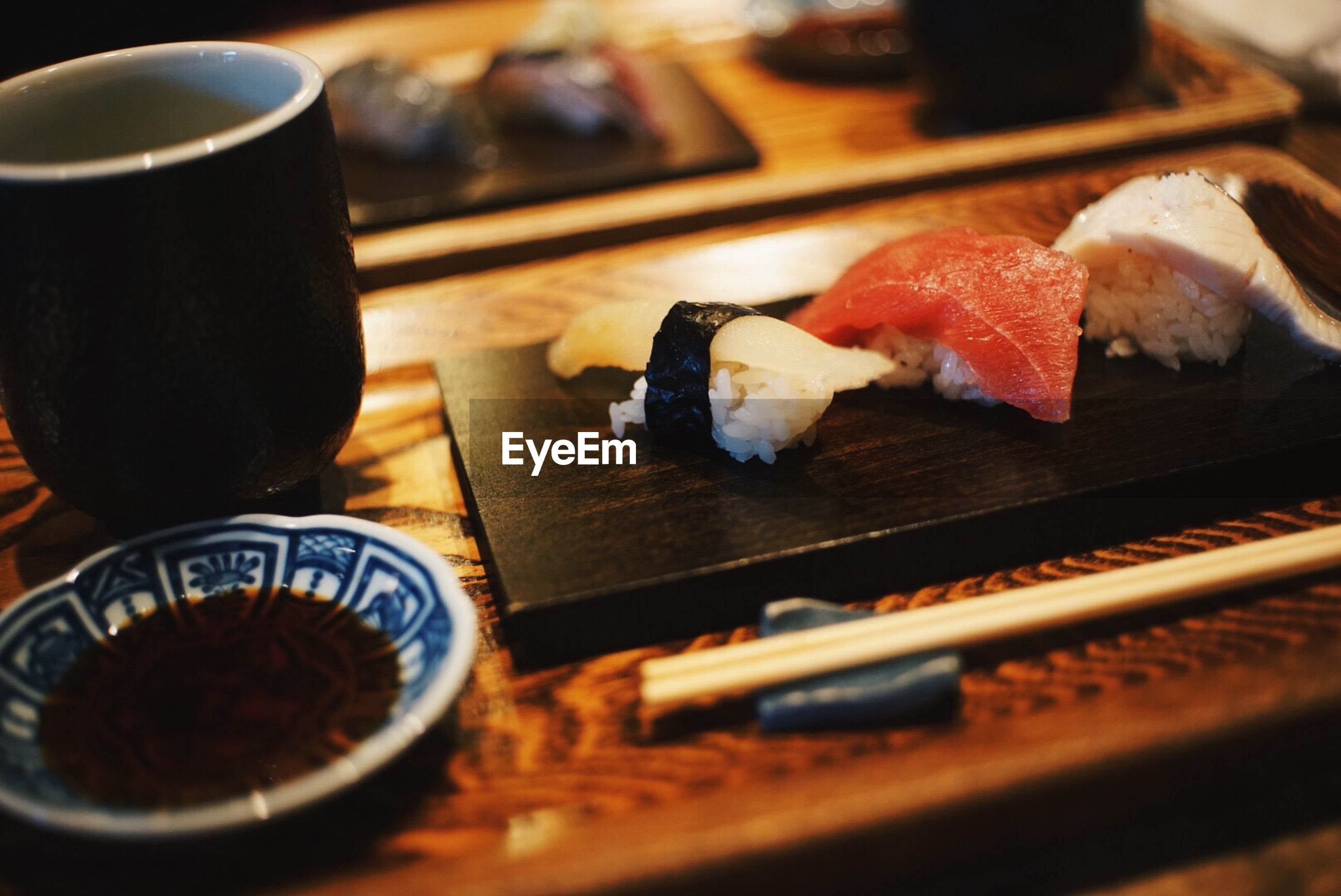 Close-up of sushi and drink on table