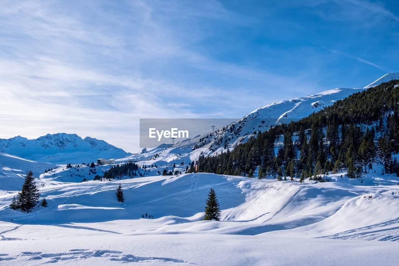 winter, cold temperature, snow, sky, beauty in nature, scenics - nature, cloud - sky, tranquility, tranquil scene, mountain, white color, non-urban scene, day, environment, nature, landscape, no people, mountain range, idyllic, snowcapped mountain, mountain peak