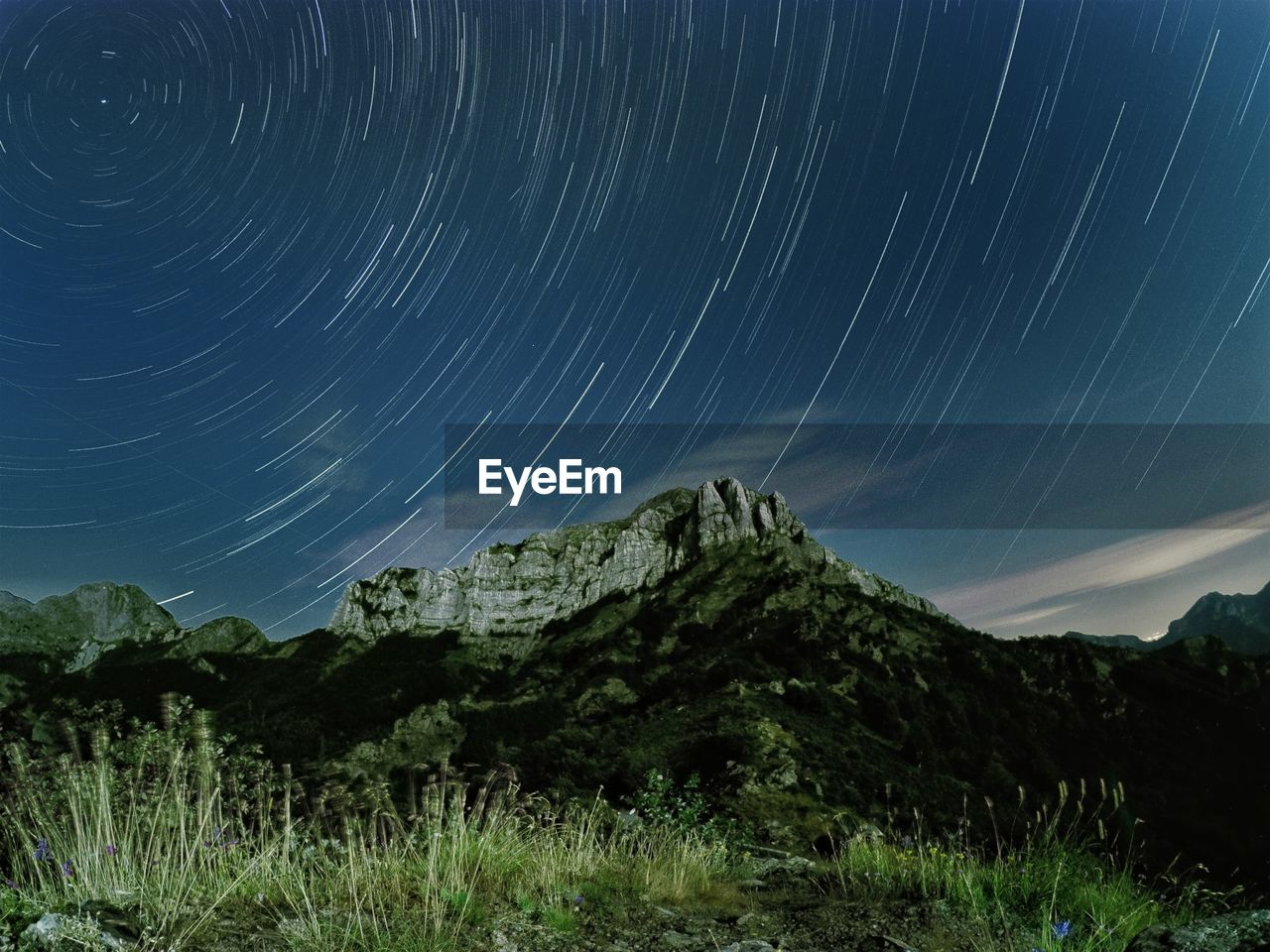 Scenic view of star field against sky at night, startrail