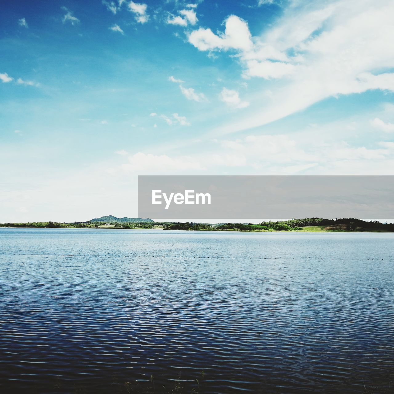 water, sky, cloud - sky, beauty in nature, tranquility, scenics - nature, tranquil scene, nature, waterfront, lake, day, no people, outdoors, idyllic, rippled, beach, reflection