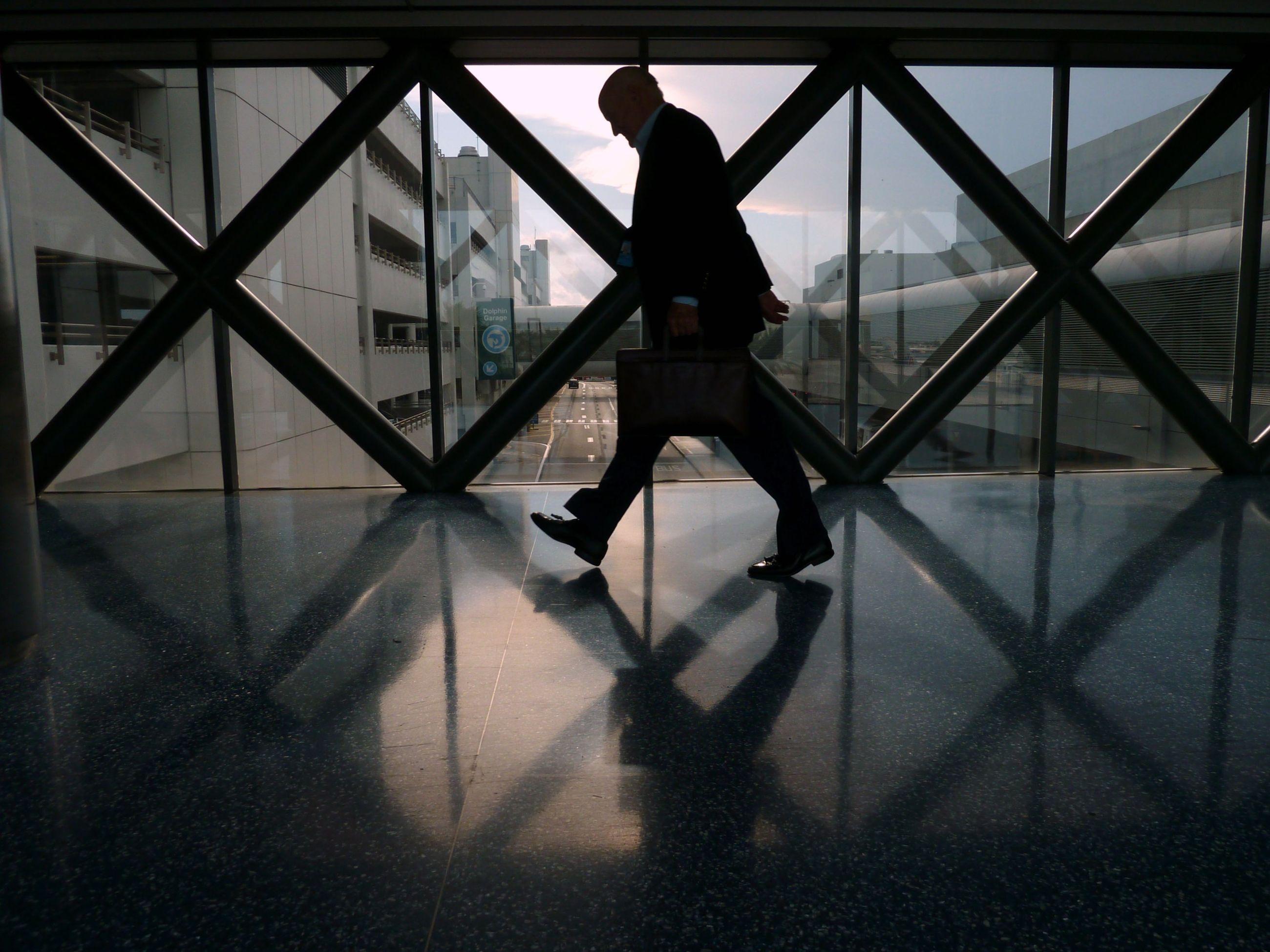 Full length on businessman walking on corridor